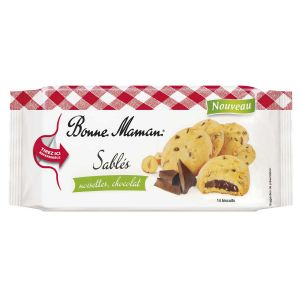 Kleine Haselnuss Cookies aus Mürbeteig mit cremiger Schokofüllung.