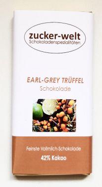 Feinste Vollmilchschokolade gefüllt mit Schwarztee (Earl-Grey)-Sanddorn-Bergamotte-Sahnetrüffel 65g